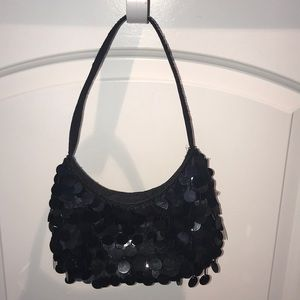 Black handbag with disc detail from Lord & Taylor